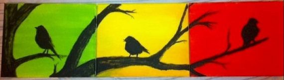 Rasta-inspired painting featuring vibrant reds, greens, and yellows supporting 3 bird silhouettes in a tree across three 8 x 10 canvas