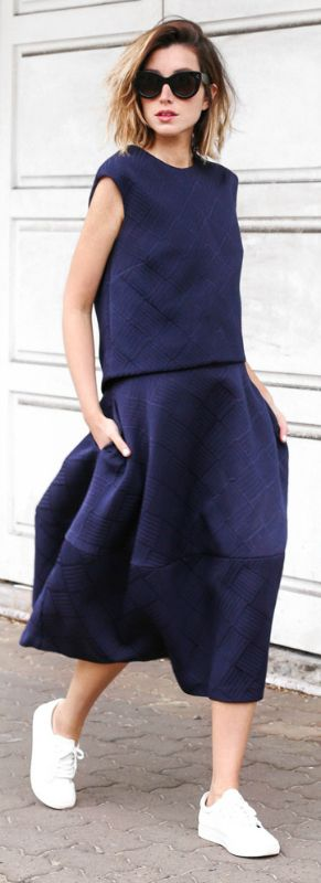Carmen Hamilton is working the two piece trend - a mid length navy blue skirt and matching top paired with white sneakers!  Two piece: Country Road