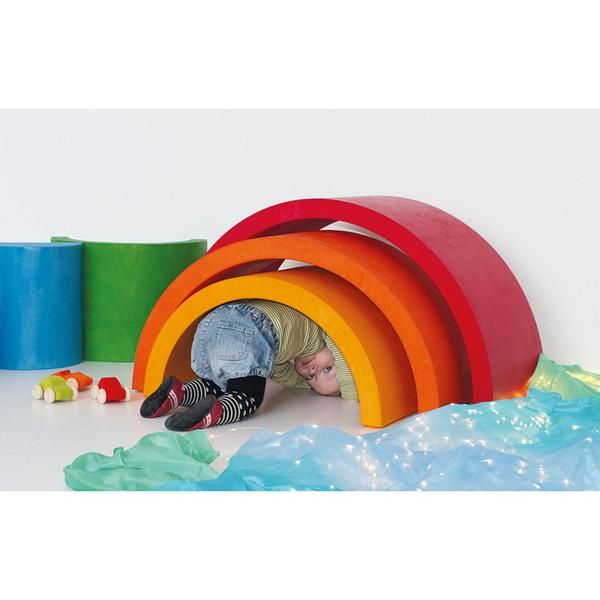 XXL Wooden Rainbow is a furniture-sized version of our popular Rainbow Tunnel stacking toy from Grimms Spiel & Holz of Germany. This extra extra large allows children to build houses, bridges, fences, hideaways, a cradle they can rock in, and more!