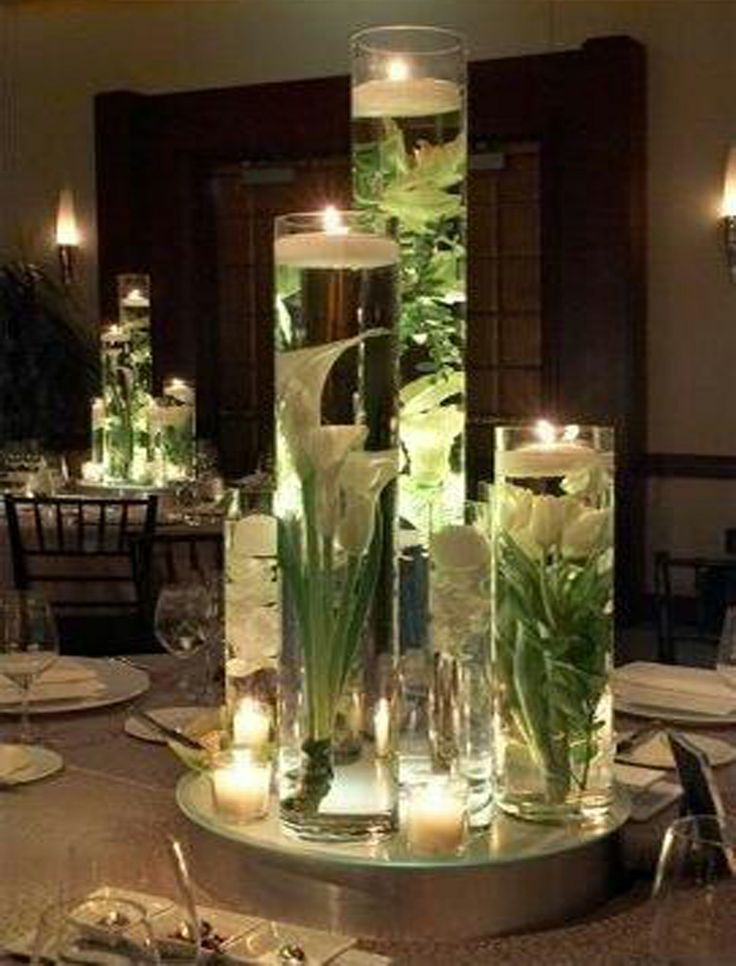 Wedding centerpieces wedding centerpieces wedding for How to make flowers float in vases