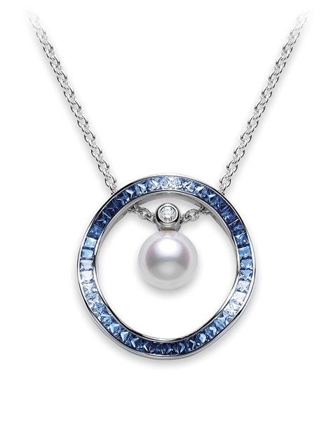 Inspired by the rippling of waves, these versatile pendants reflect a spectrum of graduated shades of blue sapphires simulating the ocean in the sunlight. The sapphire ripple is paired with an Akoya cultured pearl and diamond along an 18k white gold chain. Remove the sapphire ripple or the pearl to create the combination you desire. Mikimoto