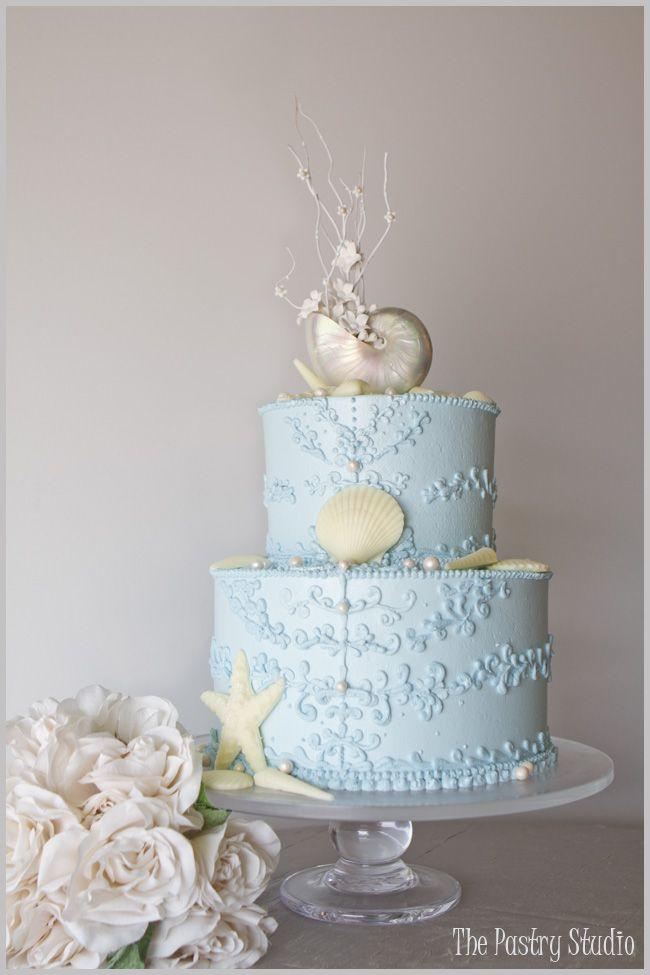 An ocean blue beach-themed wedding cake.