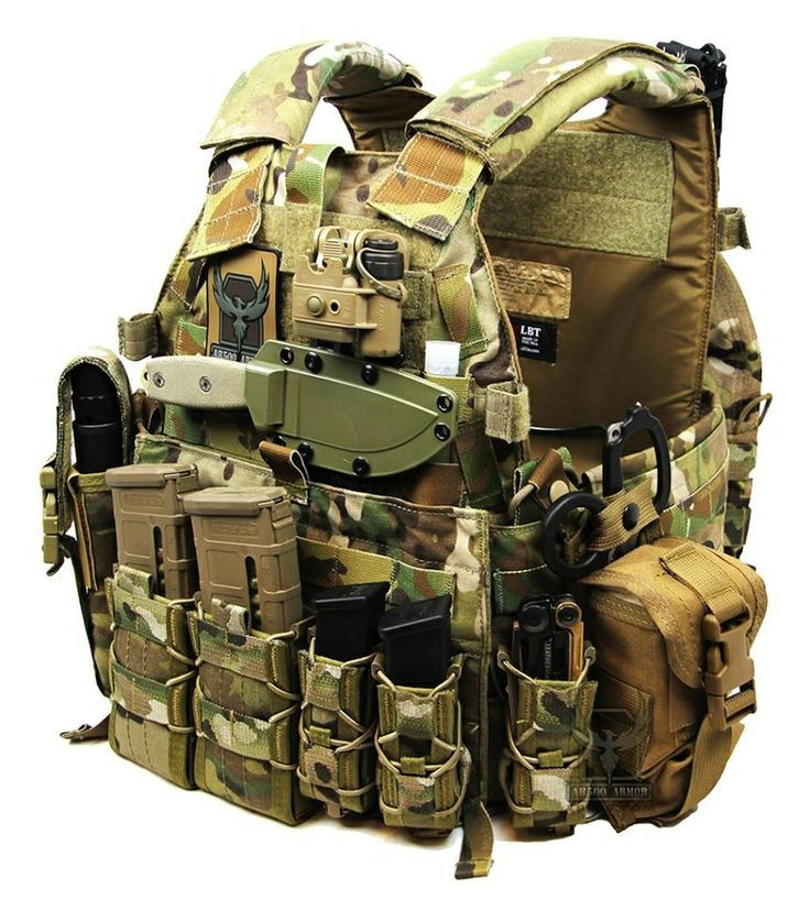 LBT plate carrier with level III body armour by AR500 Armour. ESEE 3 knife mounted via CRKT Molle clips to the sheath. SureFire helmet light stored above the knife.