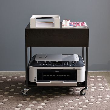 My printer is always in the way. I need one of these so i can move it around. This is by West Elm, Flat-Bar Printer Caddy