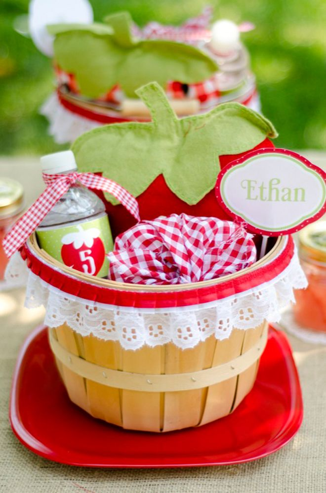 a berry strawberry picnic party! Each place setting has one! I Love the ribbon detail around the basket...cute!