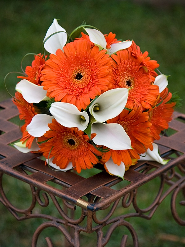 Bridal bouquet of orange Gerbera and white Calla Lilies