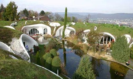 Designed by Vetsch Architecture, these eco-friendly homes in Switzerland may look a little like a 1960s commune. But their funky shapes are meant to imitate the natural rolling hills around them, and being partially buried in earth means that they are strong, energy efficient, and sustainable.