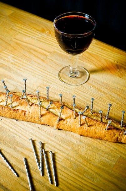 Bread is nailed into the board, and torn between the nails......(for Holy Week perhaps)