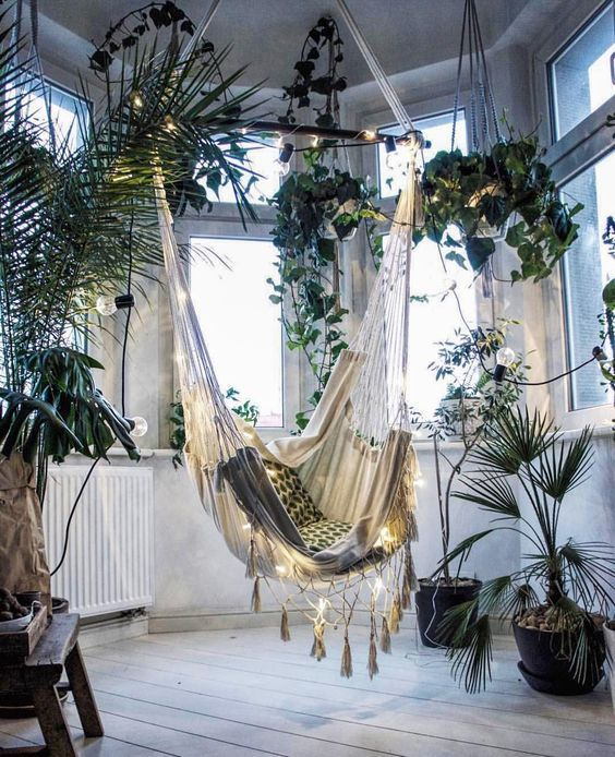 This lovely indoor hammock is a dreamy, cozy reading nook.