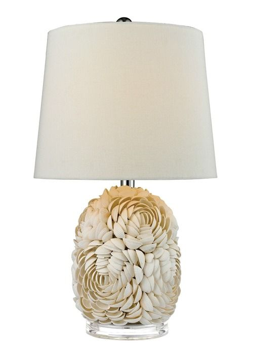 """Real shells are gathered and individually placed into the body of this 23"""" tall beach cottage lamp in a floral pattern"""
