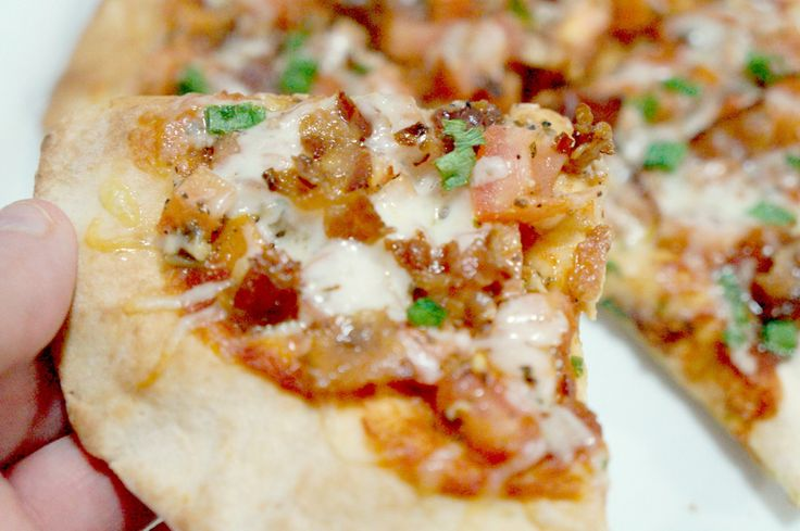 This post contains affiliate links. Read our disclosure here. These Bruschetta Pita Pizzas with Bacon are a great weeknight dinner or appetizer. This recipe produces two small pizzas and only takes twenty minutes from start to finish. This dish is inspired by East Side Mario's. I love their bruschetta pizza ( and the all you can eat garlic bread that…