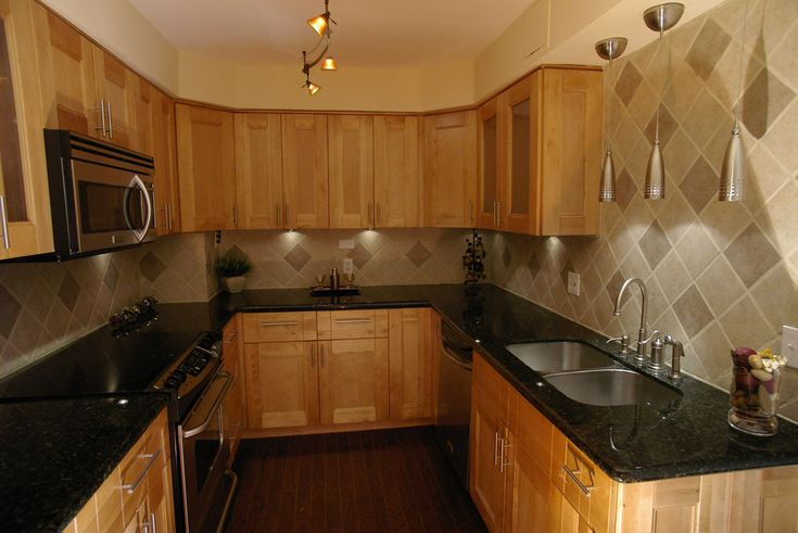 honey oak cabinets with dark hardwood floor | European Style frameless construction features: