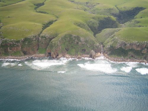 The picture with the title Transkei coastline was taken by the photographer Thomas Shields on 05 June 2008 and published over Panoramio. (Trankei, South Africa.)