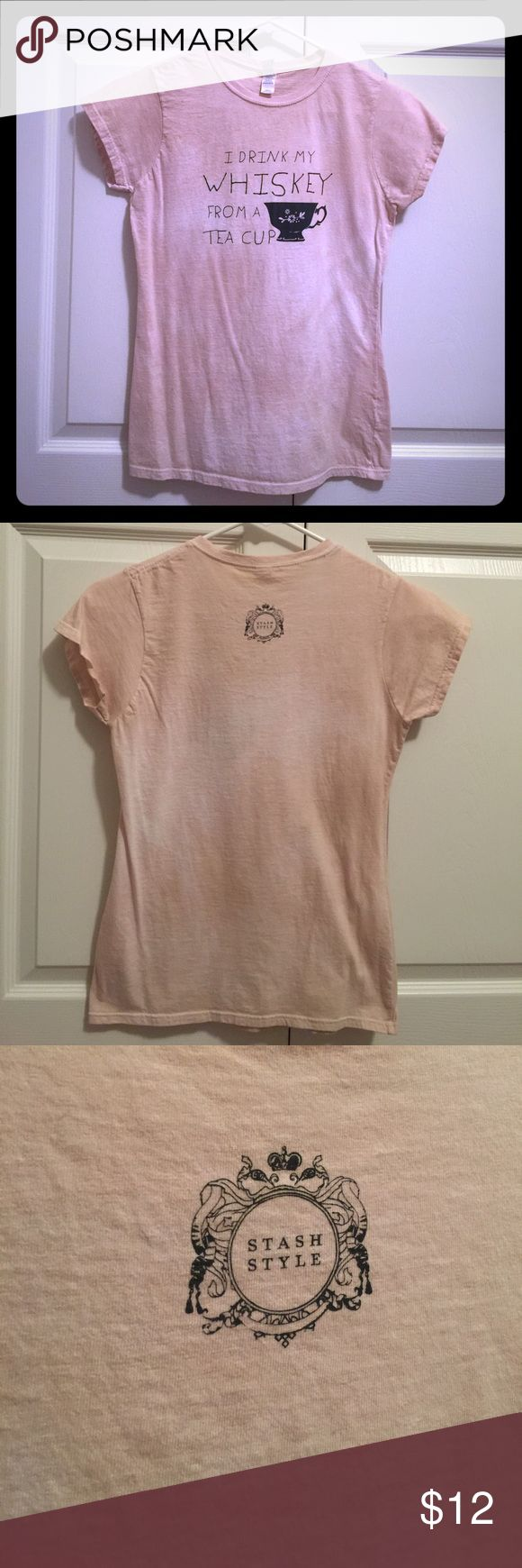 """""""I drink my whiskey from a tea cup"""" tee """"I drink my whiskey from a tea cup"""" tee, size medium and never worn! Received this tee as a gift and it's too small. The color is a washed/rustic light pink, and super cute!! Perfect for any whiskey lover like myself! Asking $6. Tops Tees - Short Sleeve"""