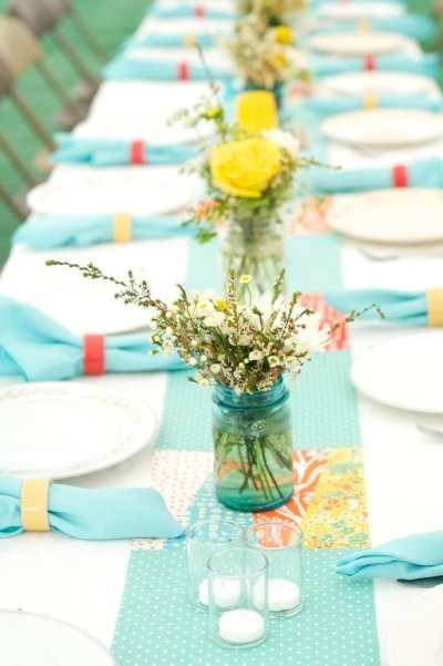 Super cute polka dot table runner -- love how the yellow roses pop!   (Credit:  A Thoughtful Place. Table Setting)