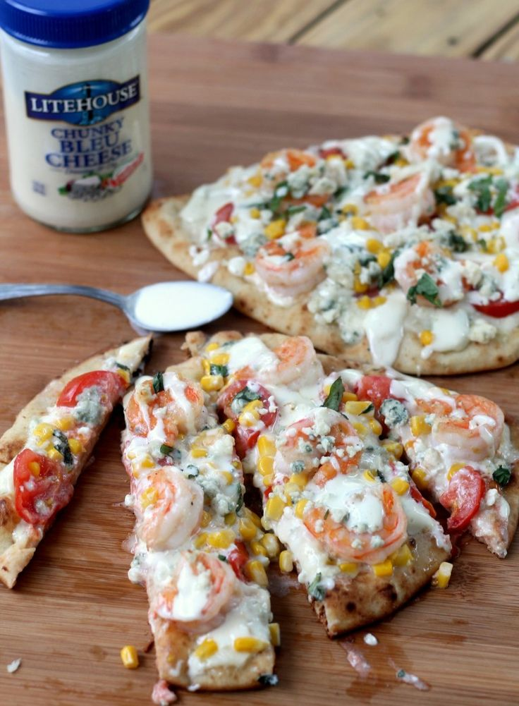 This grilled shrimp pizza with fresh veggies and bleu cheese dressing is amazing and so easy! Cut it up for the perfect party appy