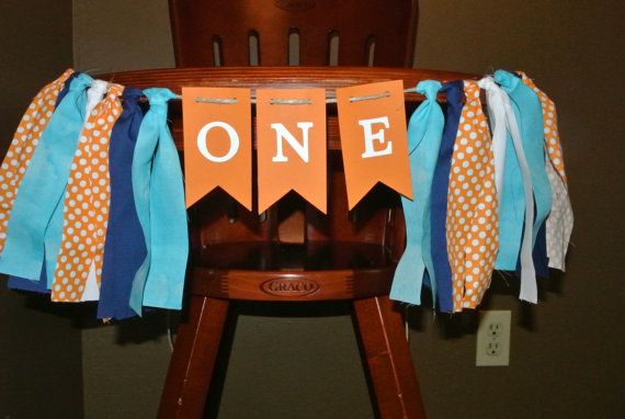 Love it https://www.etsy.com/listing/216128090/nemo-high-chair-birthday-banner-first