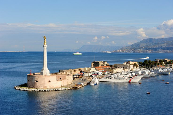 The port of Messina is a tongue of land in the middle of the Mediterranean sea. Only in Italy you can see the golden baroque times blend perfectly with the modernity of the boats