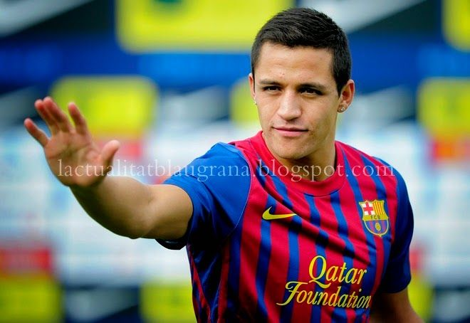 Barcelona's Chilean new player Alexis Sanchez gestures during his official presentation after signing a new contract with the Catalan club on July 25, 201, at the Sports Center FC Bacelona Joan Gamper, in San Juan Despi, near Barcelona. AFP PHOTO / JOSEP LAGO  (Photo credit should read JOSEP LAGO/AFP/Getty Images)