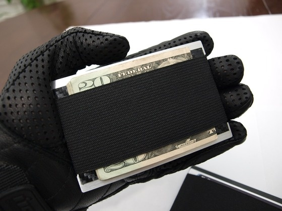 The Signataire-Magnesium. The perfect minimalist wallet. by Sheldon Petit, via Kickstarter.   Uses an RFID protection in the elastic...