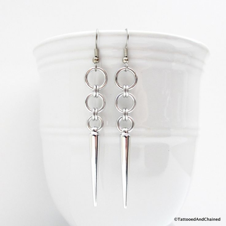 Edgy chainmaille spike earrings in neutral silver aluminum can be worn with anything. Lightweight silver colored acrylic spikes hang from a short chain of Japanese style chainmaille. The silver alumin