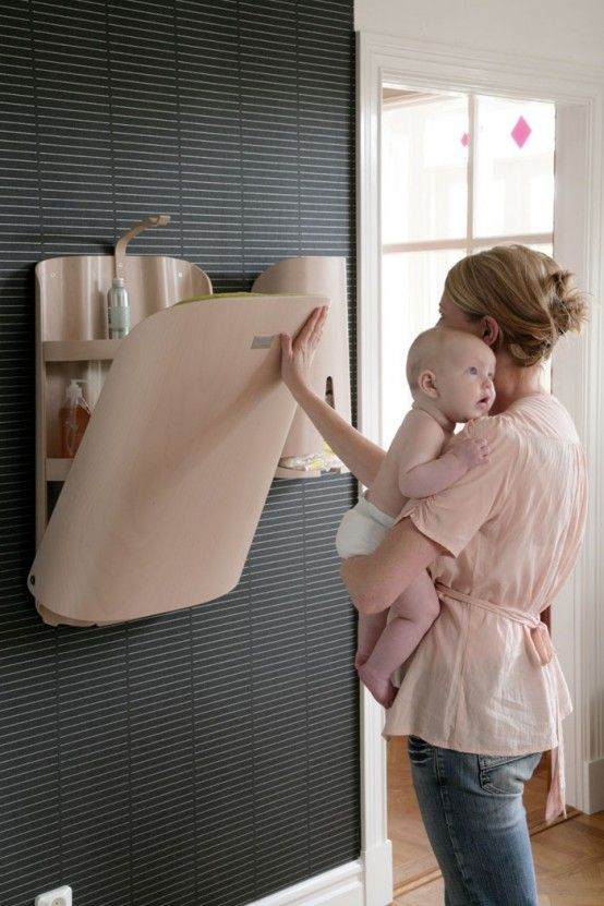 Wall mounted diaper changing station - perfect for saving space! #minimalist #design