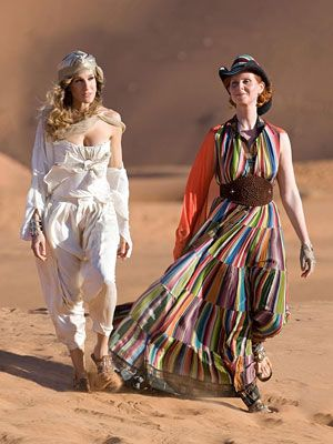 Sex and the City in Abu Dhabi. Carrie: Dior bustier, Ralph Lauren trousers. Miranda: Hermes shirtdress. #inStyle