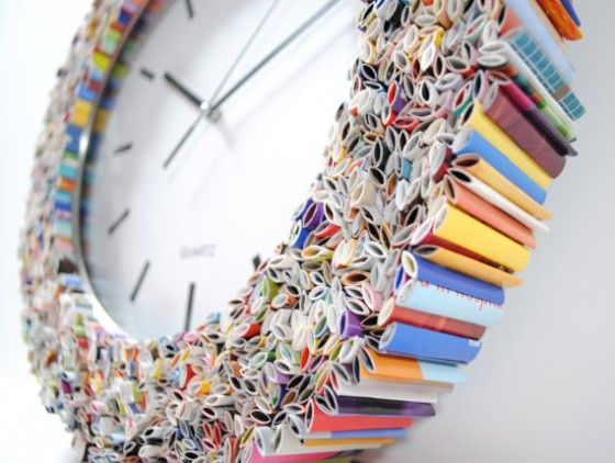 A clock made of magazine pages