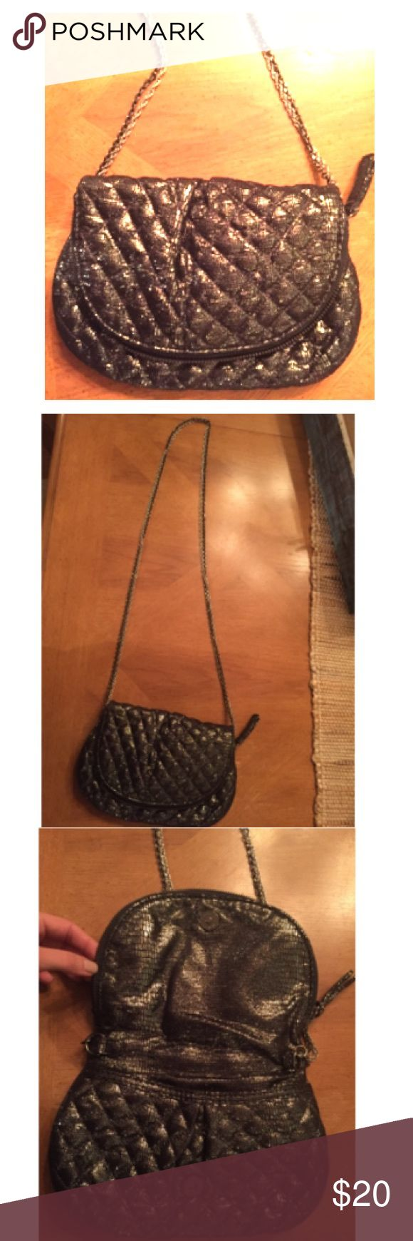 Gorgeous Gap Purse Perfect condition.  Dark metallic grey/silver. Very soft. Long double chain can be worn on shoulder or crossbody. Underneath the snap is a Front pocket, flap opens up to full size purse with zipper. GAP Bags Crossbody Bags