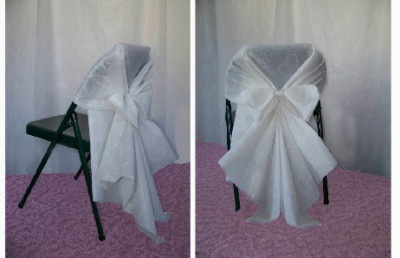 This is the pattern that I used for my chair covers at the reception.  It was sooo easy!  I didn't use the matching bows however, I made my own with organza and tulle to match the wedding colors (red and black).  I used wedding aisle runners for the fabric (it was the perfect width).  If you buy the runners at hobby lobby on sale you can make about 19 covers out of 1 roll for about $20.  There is also a you-tube video that shows how to put on the covers.