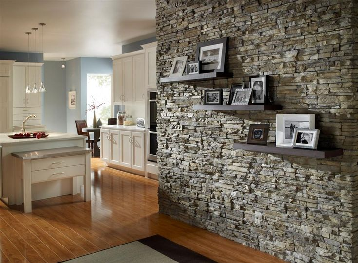 Stacked Stone Accent Wall With Floating Shelves Accent