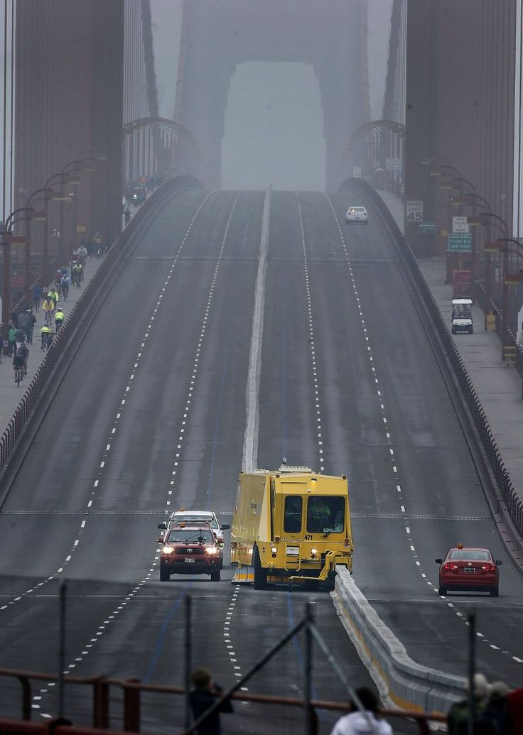 """A yellow """"zipper"""" truck moved the barrier as it practiced for the Monday commute Sunday January 11, 2015. Crews on the Golden Gate Bridge practiced with """"zipper"""" trucks on their new moveable median barrier to get ready to reopen the span Monday morning."""