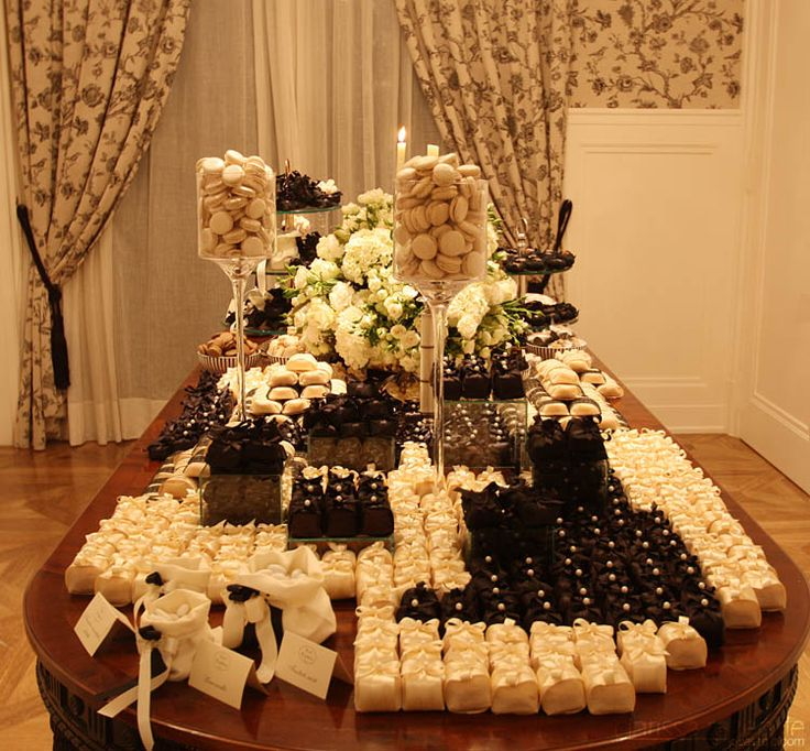 Black and white dessert table with macarons, dragees and brazilian sweets for a Canel inpired engagement party.