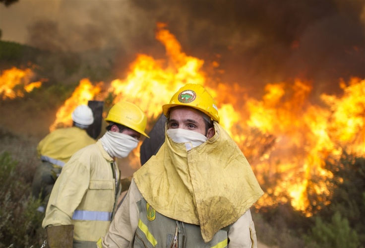 Spain is facing its worst wildfires in a decade, after more than three times as much forest has burned so far this year than in the whole of 2011, while firefighting budgets have been slashed by up to a half as part of the drive to cut public spending. (Pedro Armestre / AFP)