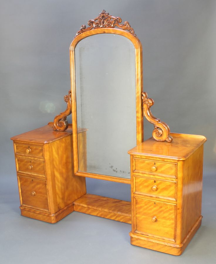 Lot 882, A John Manuel & Sons Victorian bleached mahogany dressing chest fitted an arched plate mirror flanked to each side by a 3 drawer chest est £150-200