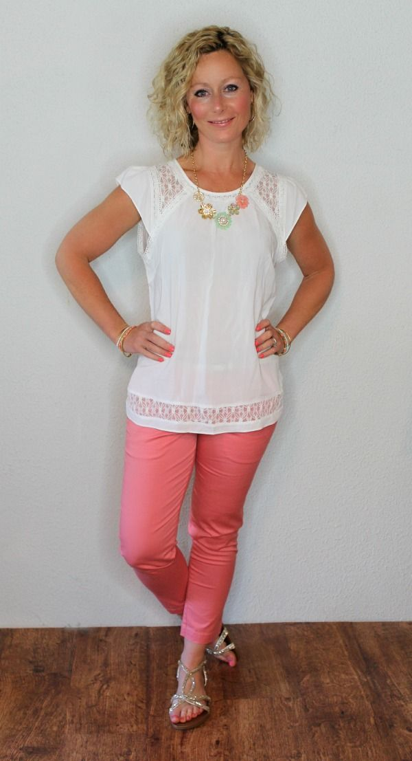 Pretty feminine top with flutter sleeves and pretty detail.  White is ok, but prefer a color if you have it. Love the coral capris