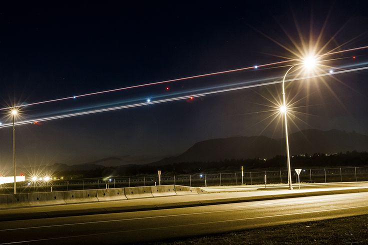 Vancouver // Long exposure of an airplane landing at Vancouver International Airport (YVR) in Richmond // Light streaks // Image by Ray Urner // www.rayurner.com