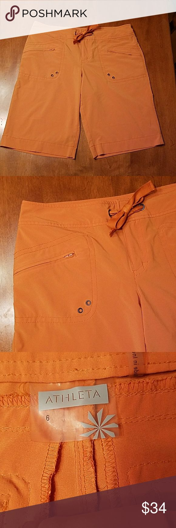Athleta muted Orange shorts women's 6 These Soft Orange shorts are stretchy and stylish. Size 6. Two front flip Pockets to back zip pockets. 86% polyester 14% spandex. Inseam measures 11 and 3/4 inches long adjustable drawstring at waist. Athleta Shorts