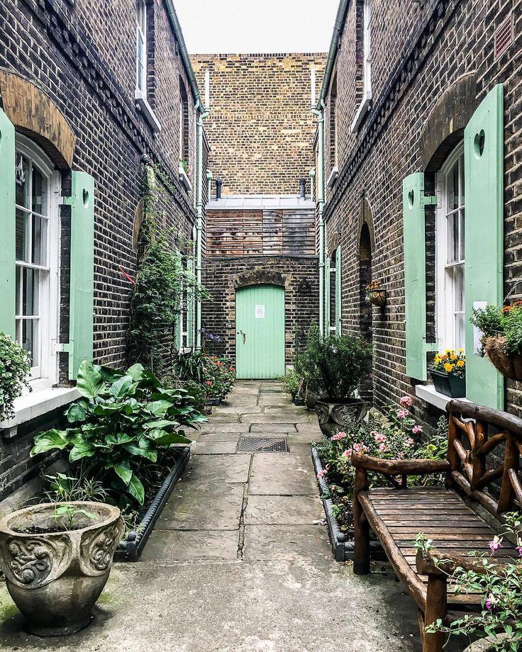 Beautiful green and brick almshouses in Spitalfields, London