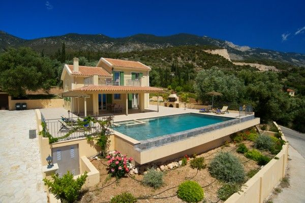 Villa Kristola is an enchanting and superbly designed modern home that commands spectacular panoramic views over rolling Trapezaki hills and Lourdas' glorious bay.