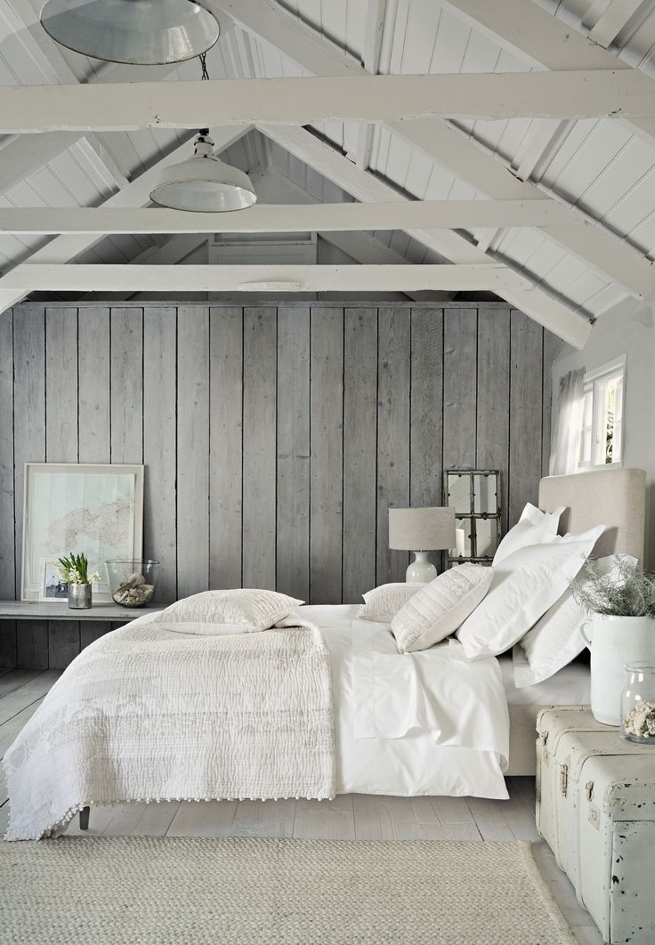 If you want a fresh, crisp feel in your bedroom, white is the ideal colour. Set it off with a light-grey wall and wooden planks for a Scandinavian industrial mood. If you want to emulate the wooden cladding, you can find wallpaper with white wood or bricks for a cheaper price.