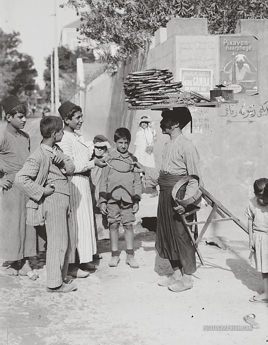 Selling bread in street. Beirut, Lebanon. late-Ottoman era, 1900-1920