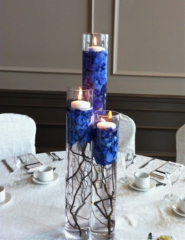 These centerpieces but with moss green petals instead of those blue petals