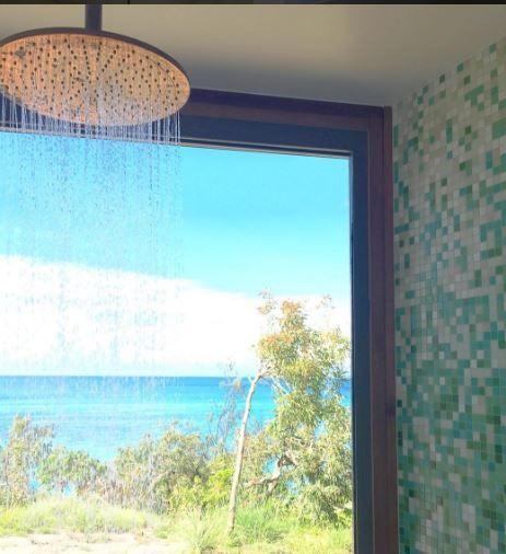 Brass rain  shower - Wilson's Cottage - Lizard Island - TWOFOLD STUDIO with James Davidson Architect