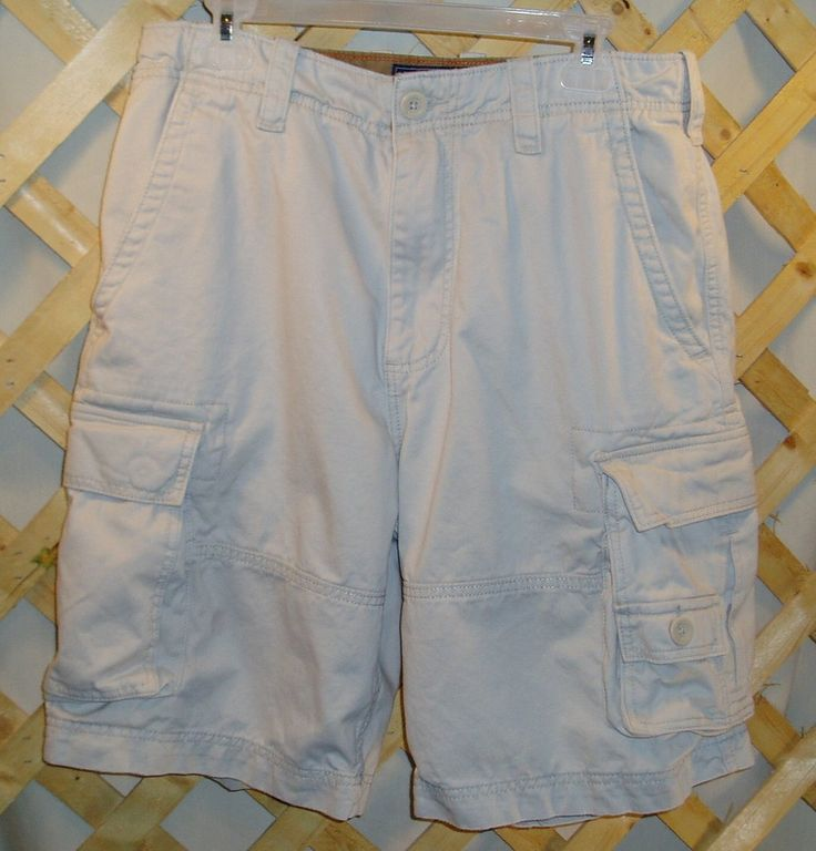 A light beige pair of American Rag shorts in size Men's size 33 with lots of pockets.