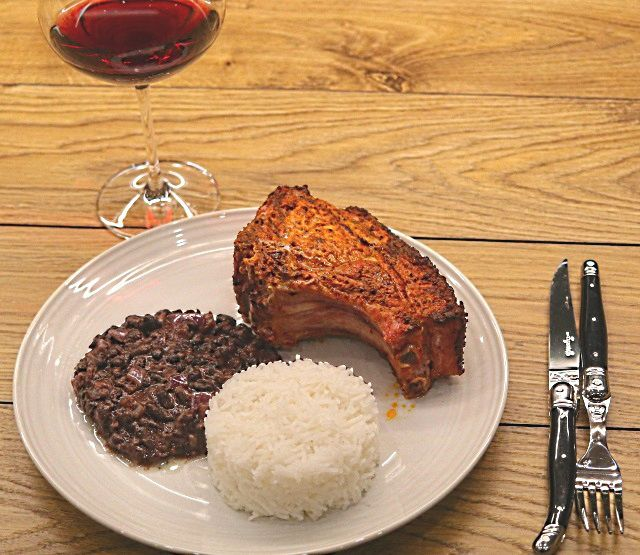 Peruvian marinated pork with black bean coconut rice