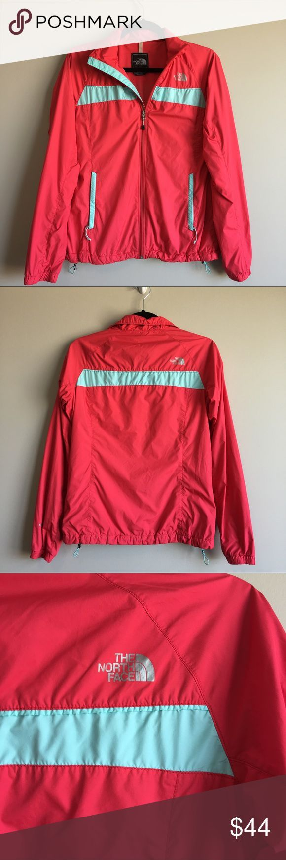 Northface bright coral red and teal windbreaker Size S Has two pockets that zip on the sizes and adjustable elastics on the bottom for a better fit Measures about 18 across the chest and 23 inches from shoulder to bottom Please feel free to message me with any questions! :) North Face Jackets & Coats