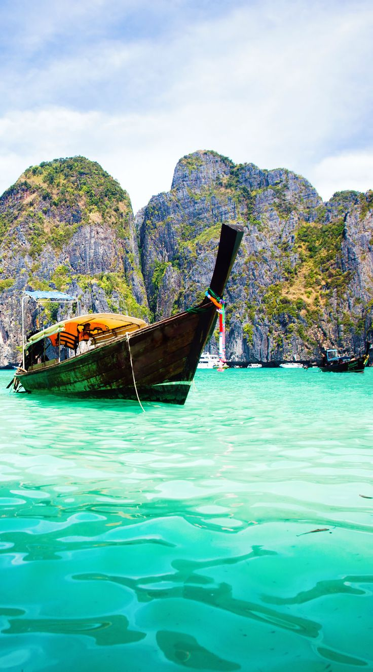 Exotic beach View and traditional Ship in Maya Bay, Ko Phi Phi Don, Thailand   |  10 Idyllic Surreal Places that Make Thailand One of the Most Beautiful Countries in The World