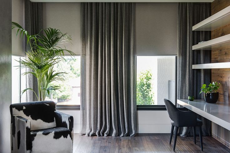 Motorised Roller Blinds in Baltic blockout fabric, paired with sheer pencil pleat curtains Alabama – Anthrazite fabric.                                                                          |                                                                          Window Furnishing: Curtains                                                                          |                                                                          Room: Study