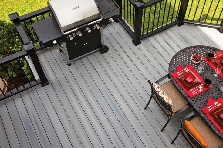 Designing a new deck? Consider adding a bump-out or other designated space for your grill. You'll keep smoke away from seating areas and give the chef some extra elbow room.  To make life even easier, install low-maintenance Horizon composite decking from Fiberon, shown here in Castle Gray.
